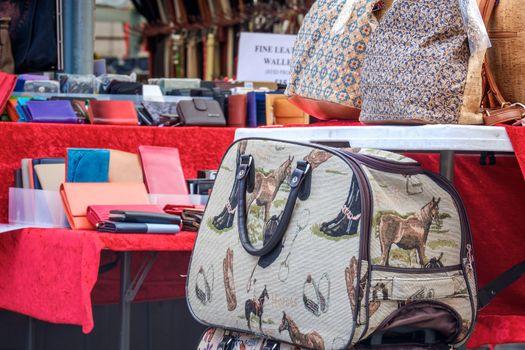 Market stall in York UK offering various bags.