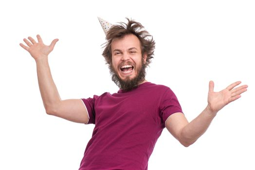 Crazy bearded Man with funny Haircut in birthday cap, isolated on white background. Happy guy screaming and keeping mouth open. Holidays, Emotions and Signs concept.
