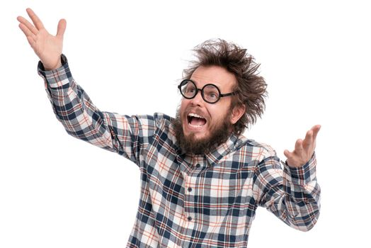 Crazy bearded Man with funny Haircut in Eyeglasses, isolated on white background. Happy guy in plaid shirt is greeting - screaming and keeping mouth open. Emotions and signs concept.