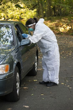 Covid19 Coronavirus healthcare worker performing virus testing outdoors for pandemic