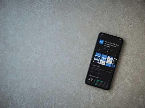 Lod, Israel - July 8, 2020: Me app play store page on the display of a black mobile smartphone on ceramic stone background. Top view flat lay with copy space.