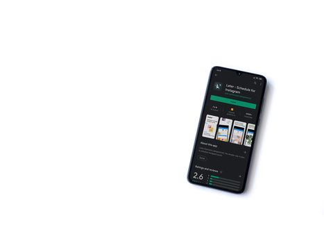 Lod, Israel - July 8, 2020: Later app play store page on the display of a black mobile smartphone isolated on white background. Top view flat lay with copy space.