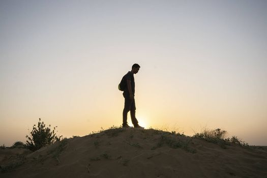 Man on sand dune, Thar Desert in Jaisalmer, Rajasthan State, India