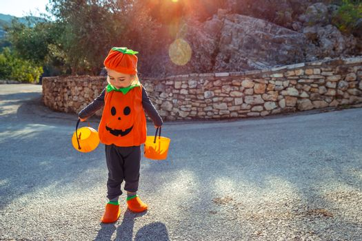 Cute Little Baby Dressed in Pumpkin Costume Having Fun on Halloween Holiday. Trick or Treat. Happy Autumnal Tradition.