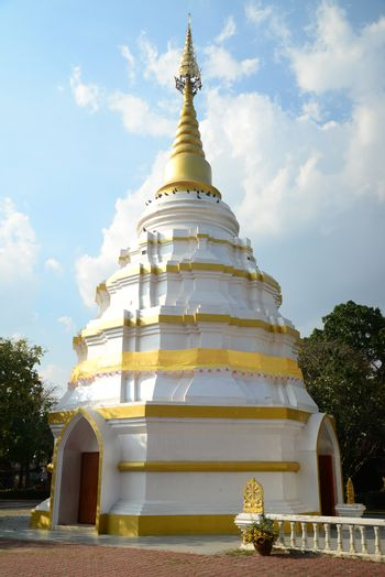 Phayao, Thailand  – 21 December, 2019 : Wat Nantaram is a Tai Yai (Shan-style) community temple in central Chiang Kham District, The brick-and-lime chedi of Tai Yai style