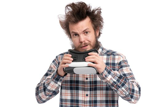 Crazy bearded Man in plaid shirt with funny Haircut wearing virtual reality helmet, isolated on white background. Portrait of funny man using VR goggles.