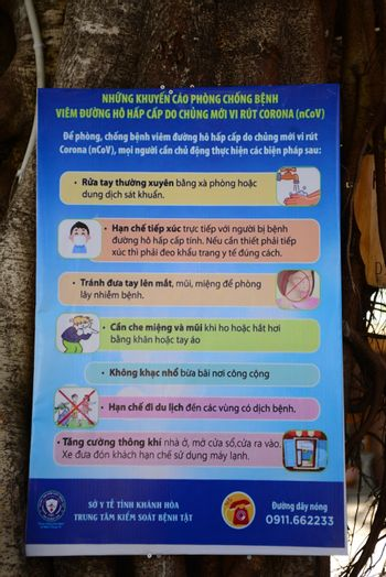 NHA TRANG, VIETNAM – 28 FEBRUARY 2020 : The label  guidance sign for the protection against Covid 19 virus is  Vietnamese In tourist spots