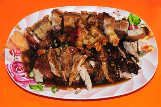Delicious Honey roast duck and crispy roast pork