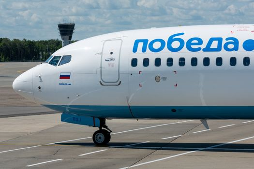July 2, 2019, Moscow, Russia. Airplane Boeing Boeing 737-800 Pobeda airline at Vnukovo airport in Moscow.