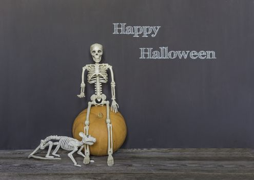 Happy halloween greeting text over dark wooden and Blackboard background