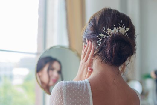 Close-up of a beautyful wedding hairstyle with hair decoration.