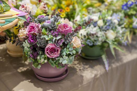 .Bouquet of beautiful multicolored artificial plants for interior decoration, soft focus, selective focus