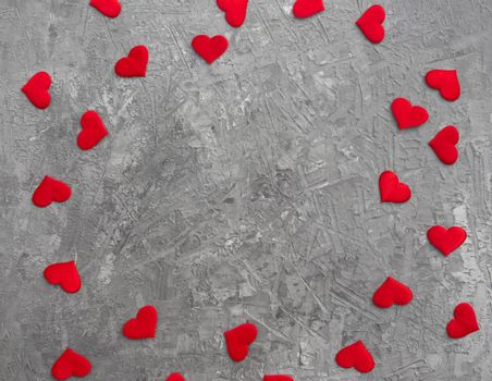 Romantic background with red hearts on concrete