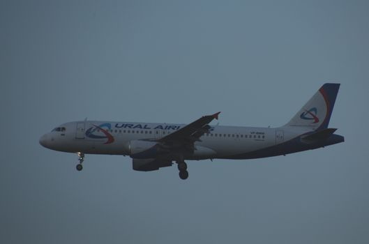 8 JULY 2018 Russia, Moscow. The aircraft Airbus A320 Ural Airlines is landing at the Domodedovo airport.