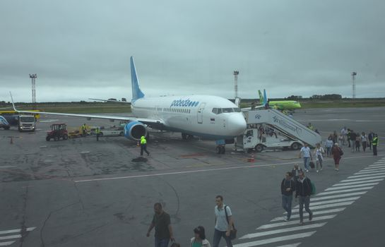 30 July 2018 Novosibirsk Russia. The aircraft Boeing 737 of the Pobeda airline at Tolmachevo airport in Novosibirsk.