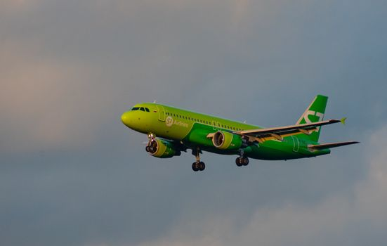 8 JULY 2018 Russia, Moscow. The aircraft Airbus A320 S7 Airlines is landing at the Domodedovo airport.