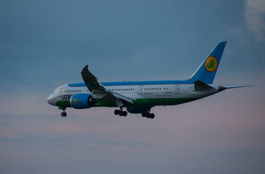 8 JULY 2018 Russia, Moscow. The aircraft Boeing 787-8 Dreamliner Uzbekistan Airways is landing at the Domodedovo airport.