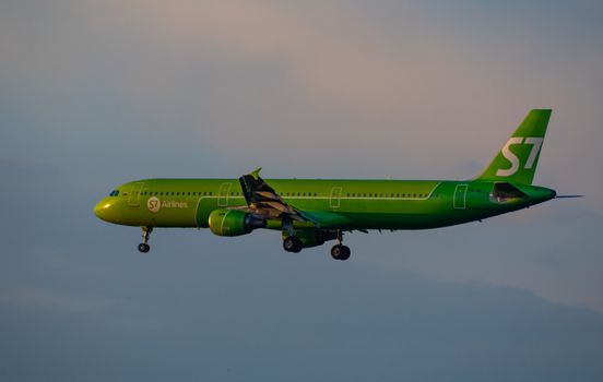 8 JULY 2018 Russia, Moscow. The aircraft Airbus A321 S7 Airlines is landing at the Domodedovo airport.