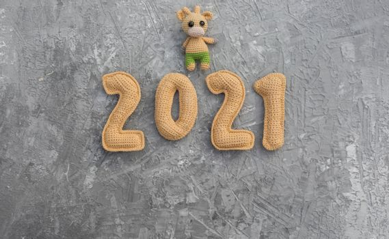 Christmas background with crocheted toy bull symbol of the year