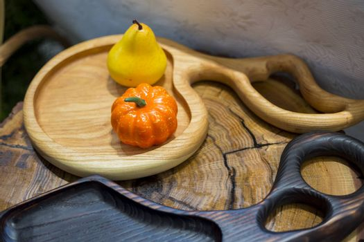 .Decorative wooden cutting boards with autumn pumpkin decorations.