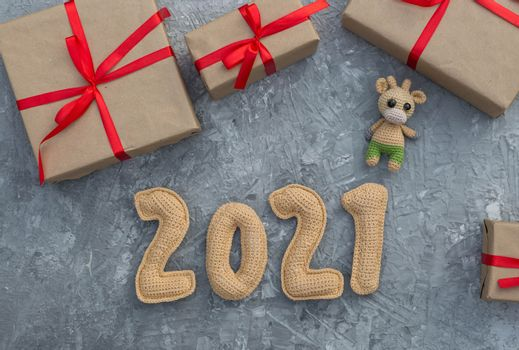 New year background with chroched toy bull symbol of chinese new year 2021 with craft paper gift boxes