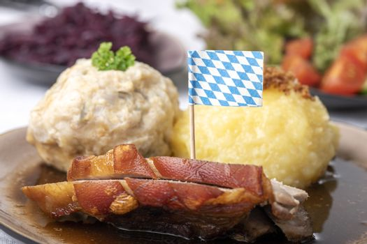 bavarian roasted pork with different dumplings