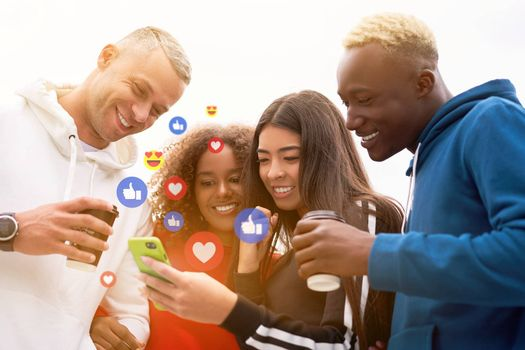 Multi-ethnic group teenage friends looking smartphone screen. African-american asian caucasian student spending time together Multiracial friendship Smiling People colorful sportswear drink coffee