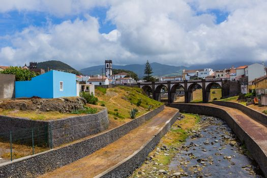 View of the bridge and church tower in Ribeira Grande town, Sao Miguel island, Azores, Portugal.