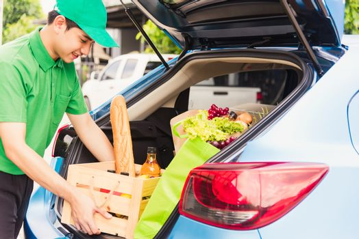 Delivery man grocery prepare fresh vegetables food in wooden bas