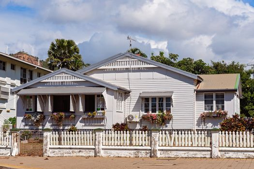 A Cottage With A White Picket Fence