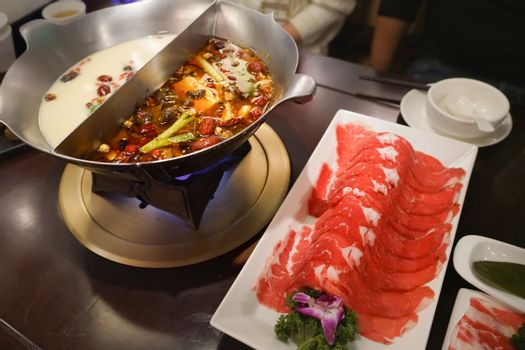 Chinese Hotpot shabu spicy and sour soup with meat and seafood,