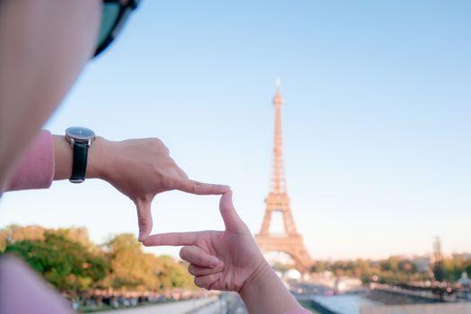 woman tourist in Eiffel tower, Paris landmark, sightseeing in Fr