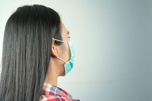 rear view of woman in mask because of air pollution and epidemic