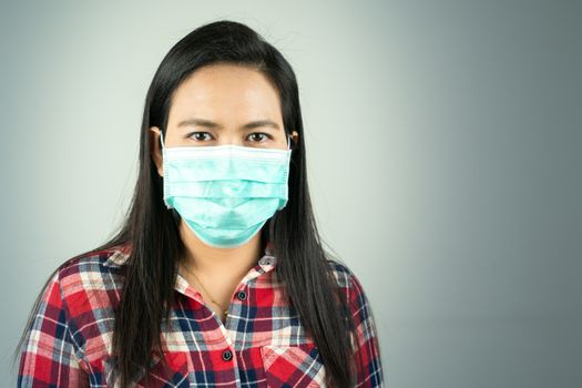 side view of woman in mask because of air pollution and epidemic