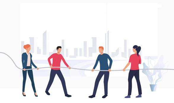 Business people competing in tug-of-war