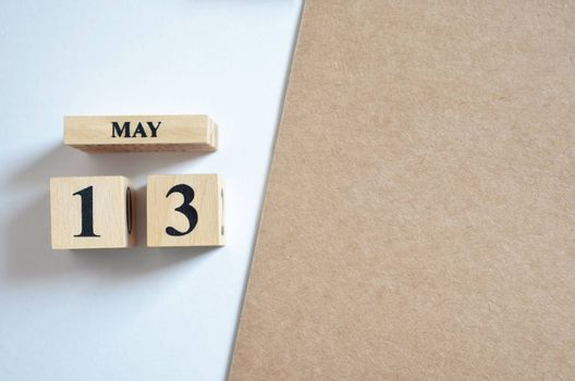 May 13, Empty white - brown background.