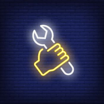 Hand with wrench neon sign