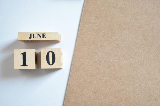 June 10, Empty white - brown background.