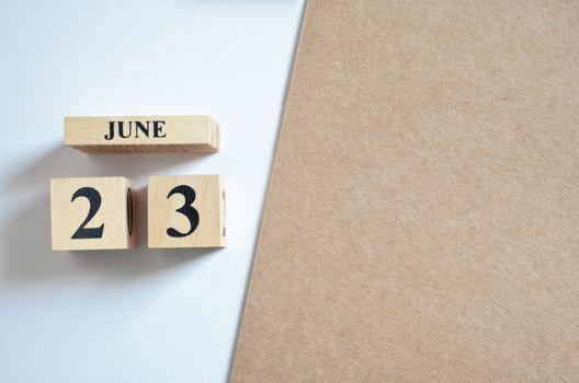 June 23, Empty white - brown background.