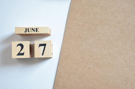June 27, Empty white - brown background.
