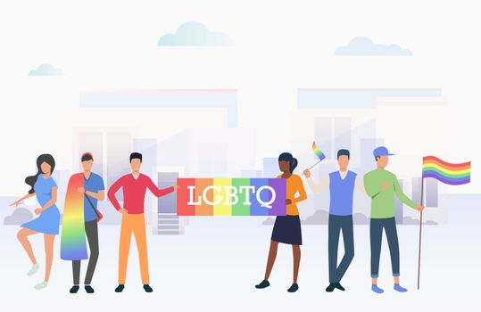 People holding LGBTQ flags in pride parade in city