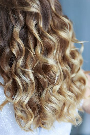 Women's curls in a professional wedding hairstyle.