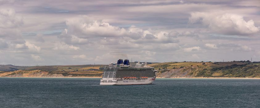 Weymouth Bay, United Kingdom - July 6, 2020: Beautiful panoramic shot of P&O cruise ship Britannia anchored in Weymouth Bay.