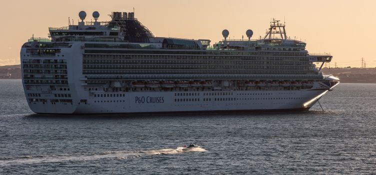 Weymouth Bay, United Kingdom - July 10, 2020: Beautiful panoramic shot of P&O cruise ship Ventura anchored in Weymouth Bay at sunset