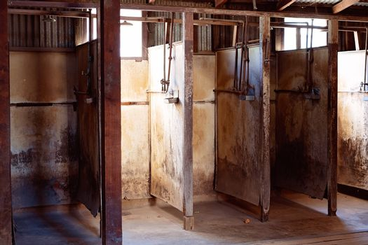 Squalid Shower Stalls Used By Gold Miners