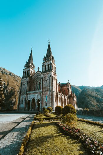A colorful shot of the cathedral of covadonga during a clear and sunny day