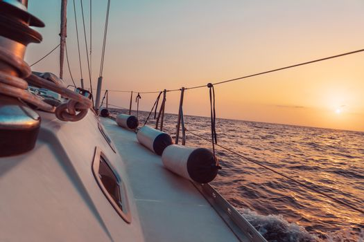 Sailboat on Sunset. Romantic Sailing in Mediterranean Sea. Luxury Summer Vacation. Active Lifestyle.