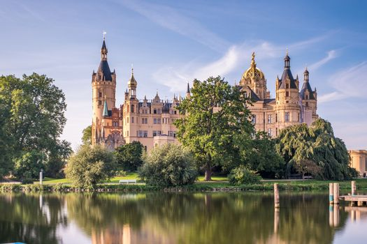 Beautiful fairytale castle in Schwerin, view from the pier