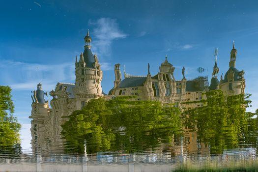 Beautiful fairytale castle in Schwerin, reflected in the lake