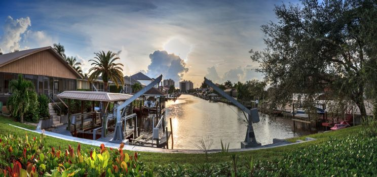 Boat lift in a waterway at sunset in Naples